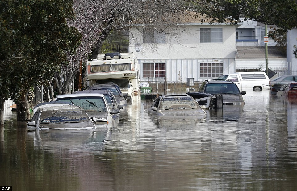 On Nordale Avenue, cars and RVs floated in the street after waters poured through the streets overnight
