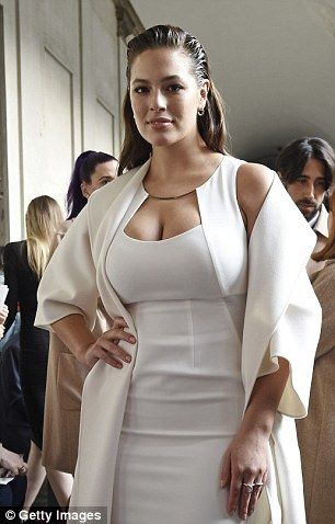 Busty: Ashley put on a busty display in a plunging ivory gown under a matching overcoat