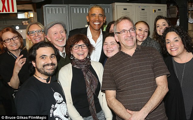 Former President Obama poses with the crew backstage at the American Airlines Theatre.Members of the Obama family have attended numerous Broadway shows