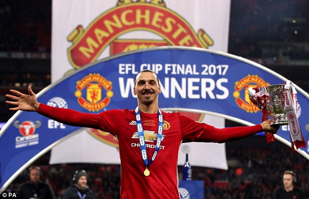 Ibrahimovic poses with the trophy after his match-winning display at Wembley