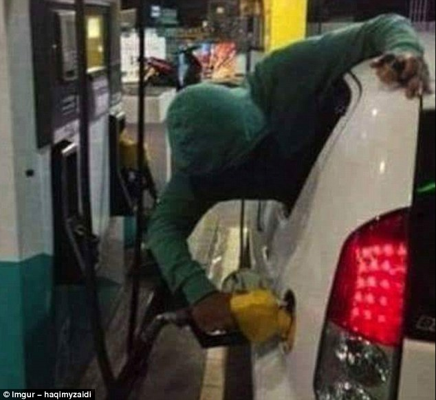 It almost feels as though this stunt would require more hassle than just getting out of the car, but this man doesn't seem to think so