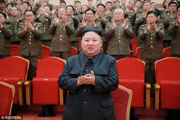 North Korean leader Kim Jong Un watches a performance at the People's Theatre on Wednesday