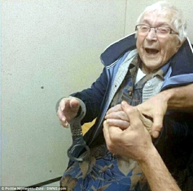 The 99-year-old is all smiles as she is taken into custody by police officers in the Netherlands