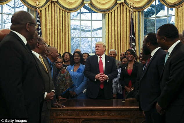 He's pictured with leaders of historically black colleges yesterday during an impromptu meeting in the Oval Office