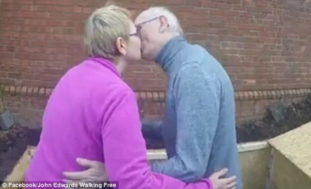 John Edwards, from Dublin, Ireland, kissed his wife Trish goodbye before being buried alive inside a coffin in the grounds of a church today