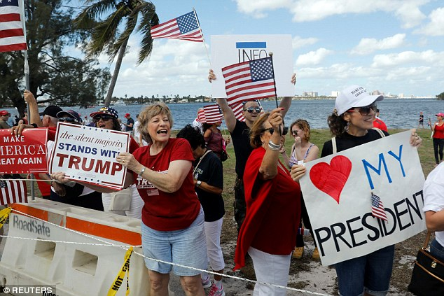 As the president returned to Mar-a-Lago this weekend, his route was lined with dozens supportive signs and messages from fans donning American flags