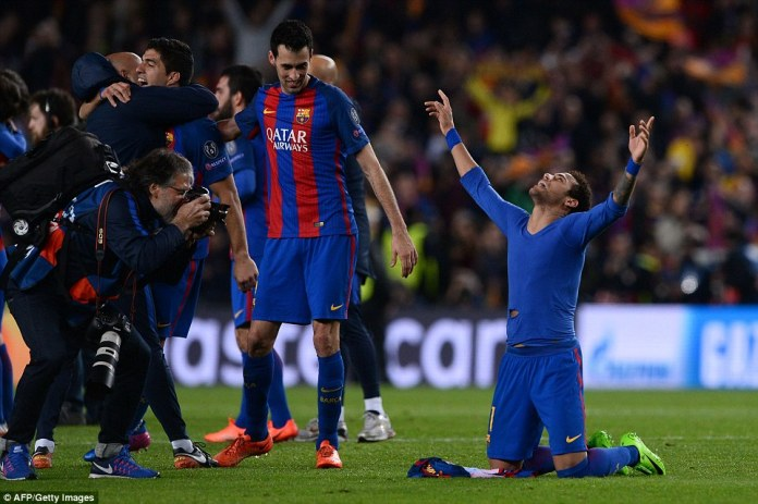 Neymar drops to his knees in celebration after Barcelona beat PSG to reach the last eight of the Champions League