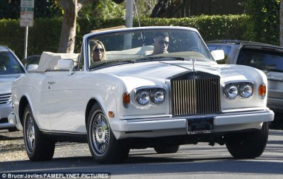 Switching it up: Perhaps wanting to give her a break after her automobile accident the day before, Russell also took over driving duties when the pair climbed into a vintage Rolls Royce convertible