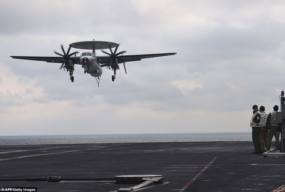 "The all-weather E-2 Hawkeye airborne early warning and battle management aircraft has served as the ""eyes"" of the U.S. Navy fleet for more than 30 years"