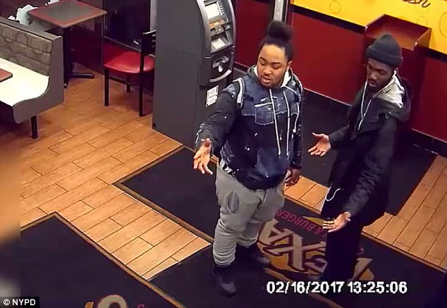 The 37-year-old offered to spot two men (pictured) when they didn't have enough money to pay for their meal at Texas Chicken and Burgers in New York on March 1