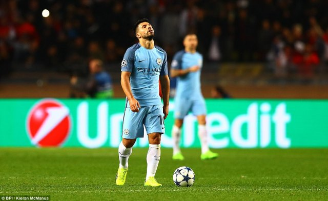 Sergio Aguero looks dejected as he walks the ball back to the halfway line after Manchester City went 2-0 down in Monaco