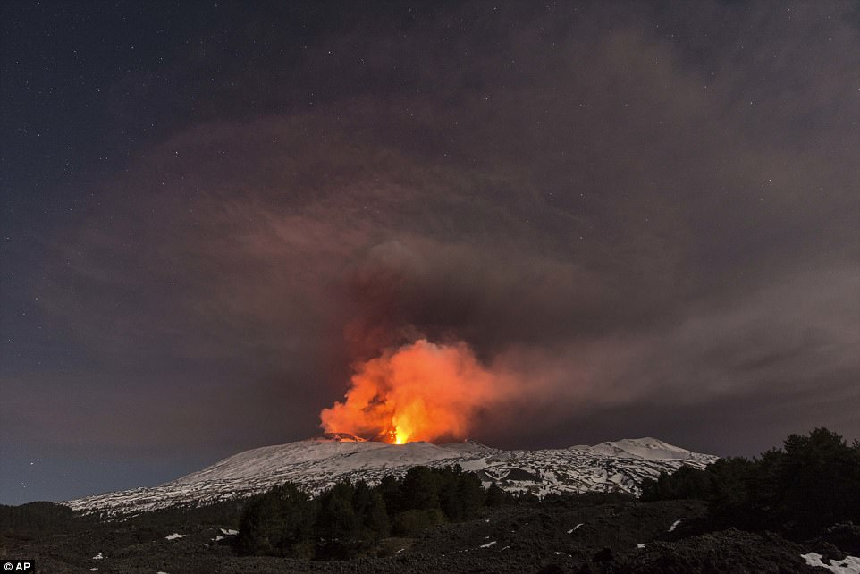 Snow-covered Mount Etna, Europe's most active volcano, spews lava during an eruption in the early hours of Thursday