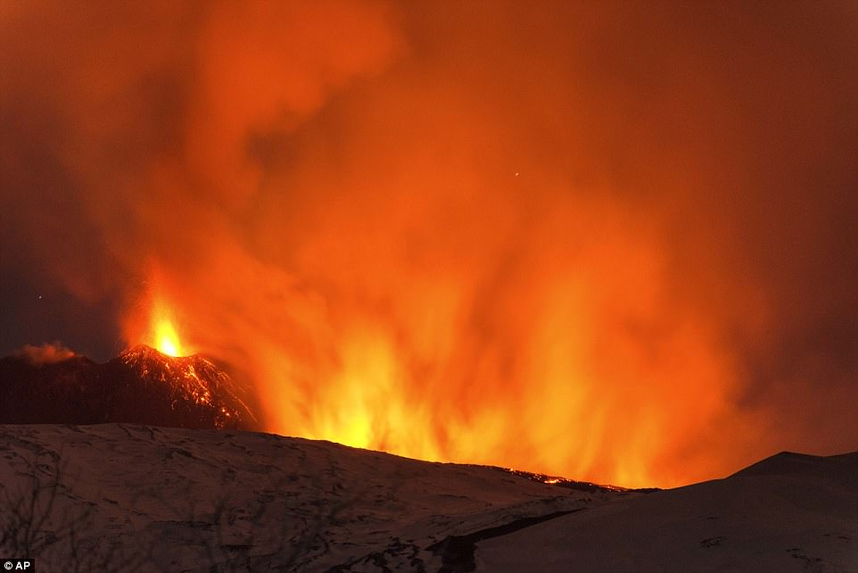 Mount Etna is pictured erupting in the early hours of Thursday.'Many injured - some head injuries, burns, cuts and bruises. Volcanologist said most dangerous incident experience in his 30 year career,' a BBC journalist at the scene said