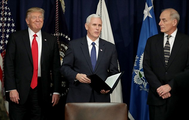 Democratic lawmakers have written to Homeland Security Secretary John F Kelly (pictured, right, alongside President Trump and Vice President Mike Pence) raising concerns about hacking of cellphone networks
