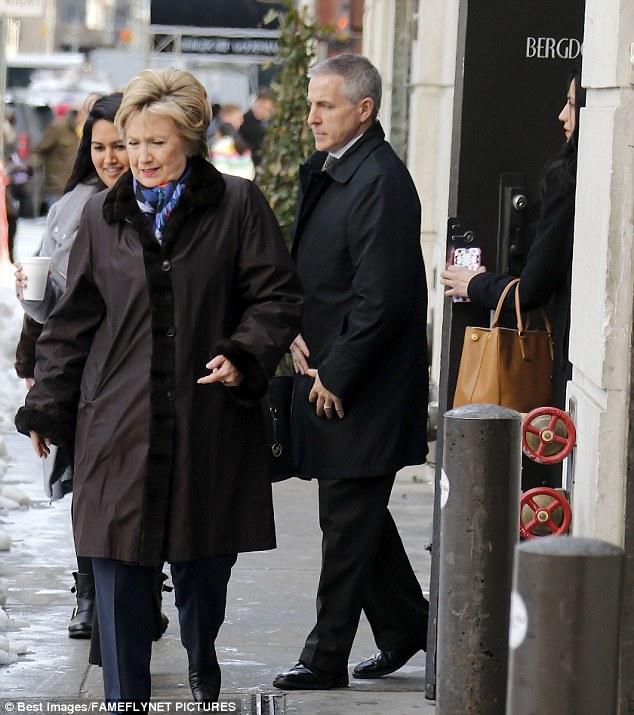 Reunited:Hillary Clinton (left) stopped by the John Barrett Salon in Bergdoof Goodman on Thursday with Huma Abedin (right)