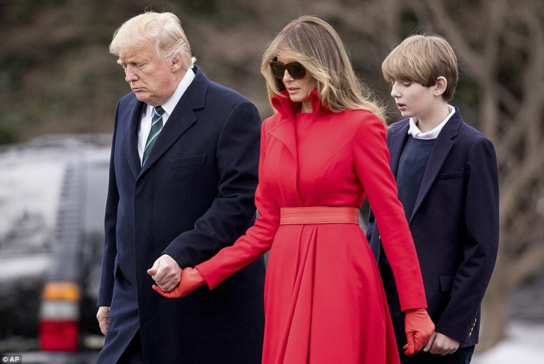 Slaying with her style: Melania managed to steal the show however, outfitted in a stunning red coat dress which she wore with matching red leather belt and gloves