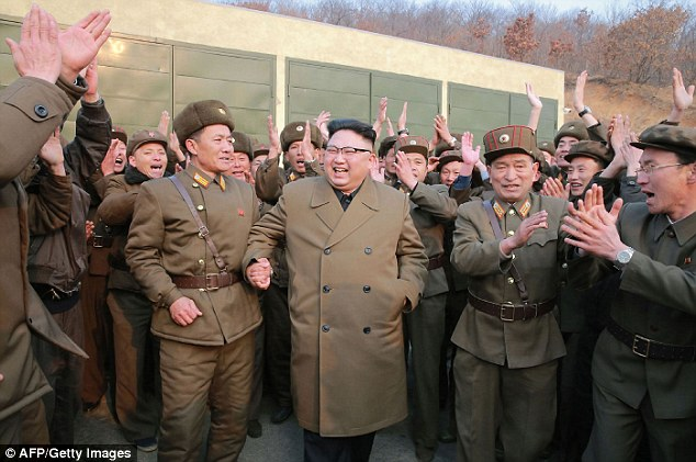 Kim Jong-Un has threatened to reduce the US 'to ashes' with nuclear weapons if American fires 'even a single bullet' at North Korea. He is pictured yesterday inspecting the ground jet test of newly developed high-thrust engine at the Sohae Satellite Launching Ground in North Korea