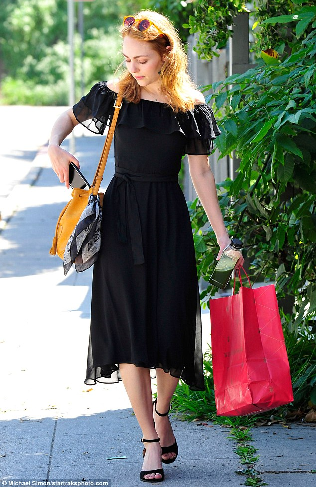 Chic: She teamed the LBD with matching peep-toe sandals, a black satchel and round earrings