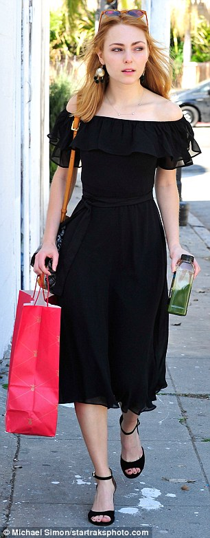 Prepared: The Carrie Diaries actress was energized for errands with a healthy green drink