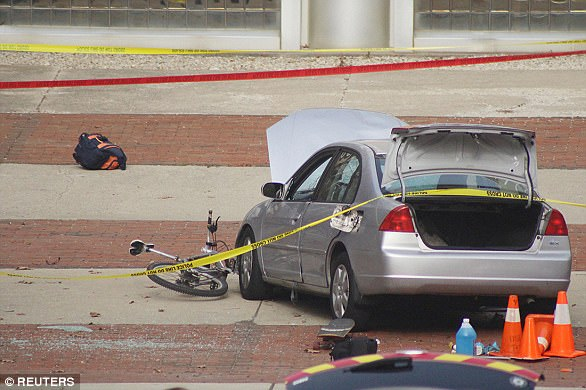 A car which police say was used by an attacker to plow into a group of students is seen outside Watts Hall on Ohio State University's campus in Columbus, Ohio