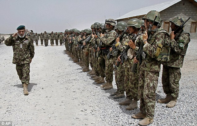 Taliban fighters have captured the strategic district of Sangin in the southern Afghan province of Helmand, officials said on Thursday.The district was captured after an Afghan officer turned his rifle on sleeping colleagues, killing nine policemen. Pictured above, Afghan National Army soldiers in the Sangin district