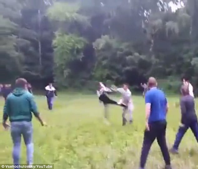 The brawl begins with a solitary fan running across the field and planting a karate kick