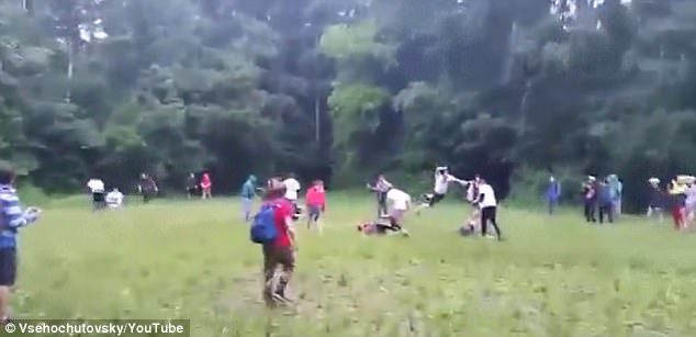 One hooligan could be seen dashing across the field before a flying attack on a downed foe