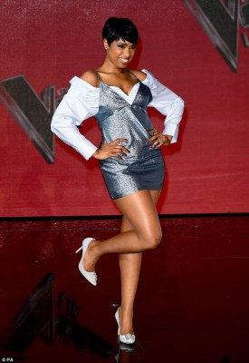 She's eclectic: Jennifer Hudson sported a glittery silver disco dress overt the top of a striped shirt as she took part in a photoshoot for The Voice final