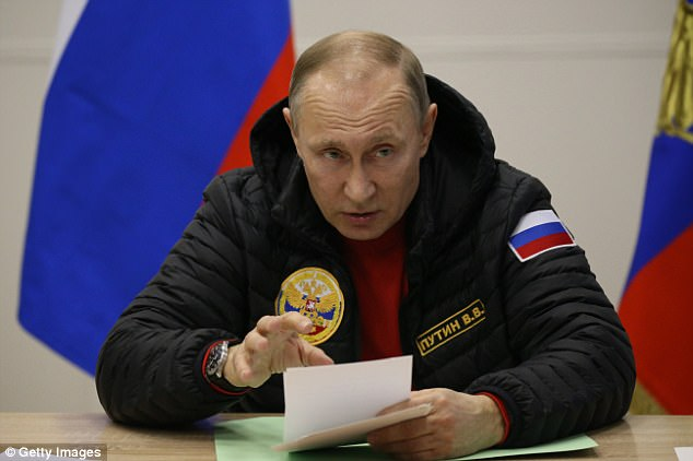 Russian President Vladimir Putin denied interfering in the U.S. elections by paraphrasing the famous 'Read my lips' quote. Here he attends a meeting at the polar camp at Alexandra Land Island on March 29, 2017 in Franz Joseph Land, Russia