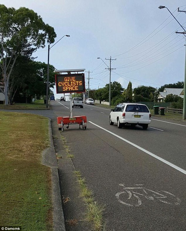 This sign tells drivers to give cyclists more space while inadvertently taking up the majority of the bike lane