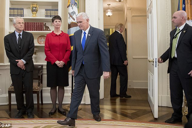 Pence was forced to walk back to Trump's desk to pick up the executive orders after Trump left the room
