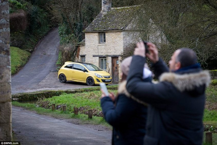 Mr Maddox, 84, scrapped the bright yellow car he parked outside his home in Bilbury, Gloucestershire (pictured) after vandals scrawled 'move' on the bonnet