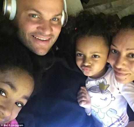 Happier times: Mel B claims Belafonte, pictured with her and two of her children, 'placed both of his hands around her neck, began choking her and slammed her down onto the hardwood floors' while she was preparing for US talent show Dancing With The Stars