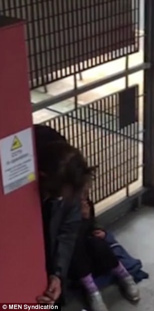 The CCTV video shows people slumped over and sitting on the floor while others are seen trembling
