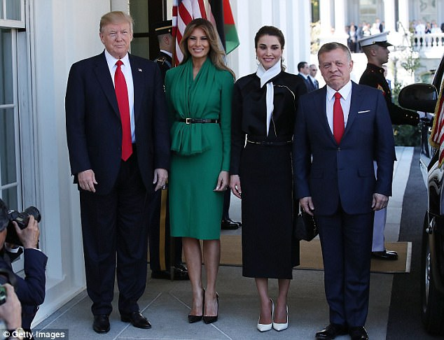 PICTURE PERFECT: U.S. President Donald Trump and his wife First Lady Melania Trump welcome King Abdullah II Hussein of Jordan and his wife Queen Rania of Jordan at the West Wing of the White House. Trump and Abdullah both wore blue suits with red ties for the occasion - and their wives had on dresses, each sporting a black belt