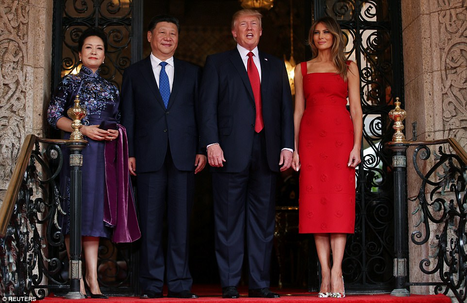 President Donald Trump and first lady Melania Trump stood at the doors of the president's Mar-a-Lago resort to officially welcome Chinese President Xi Jinping and his wife, Peng Liyuan