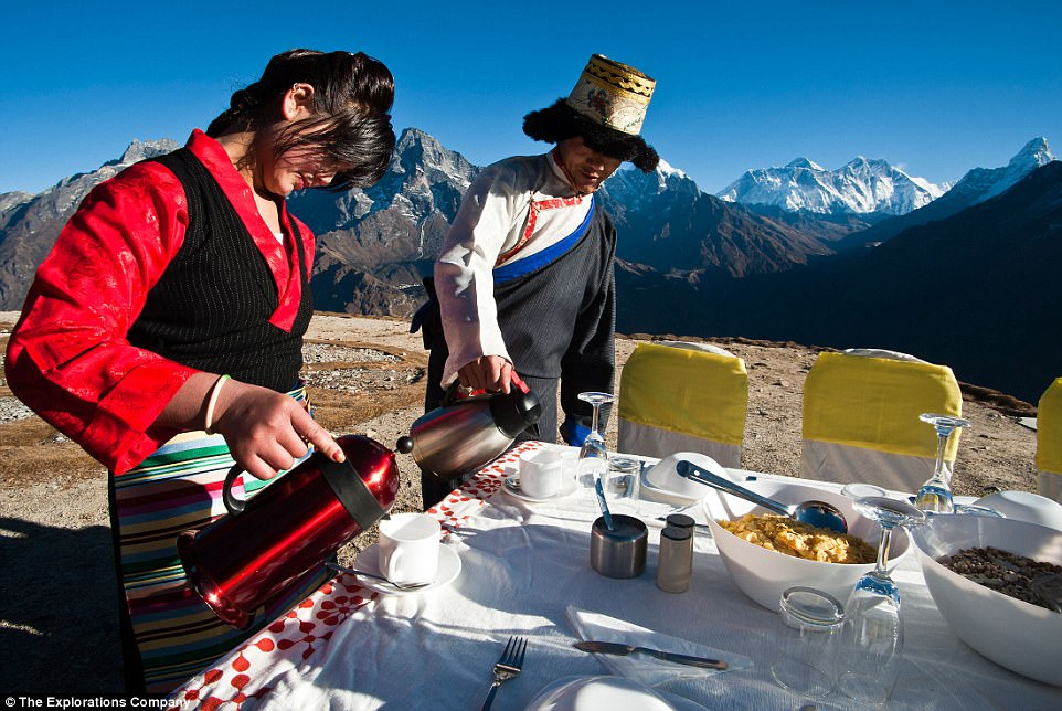 Crowd-pleaser: The Explorations Company, which is based in Gloucestershire, says it has lots of interest in the 'breakfast at Everest' trip (above, Nepalese servers prepare the breakfast table)