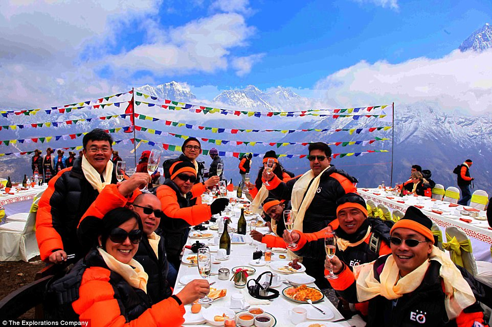 Champagne night: A plethora of travel companies are now offering 'breakfast at Everest' packages, with most costing in the region of £3,000 to £4,000 per person (above, The Exploration Company hosts a diner for clients)