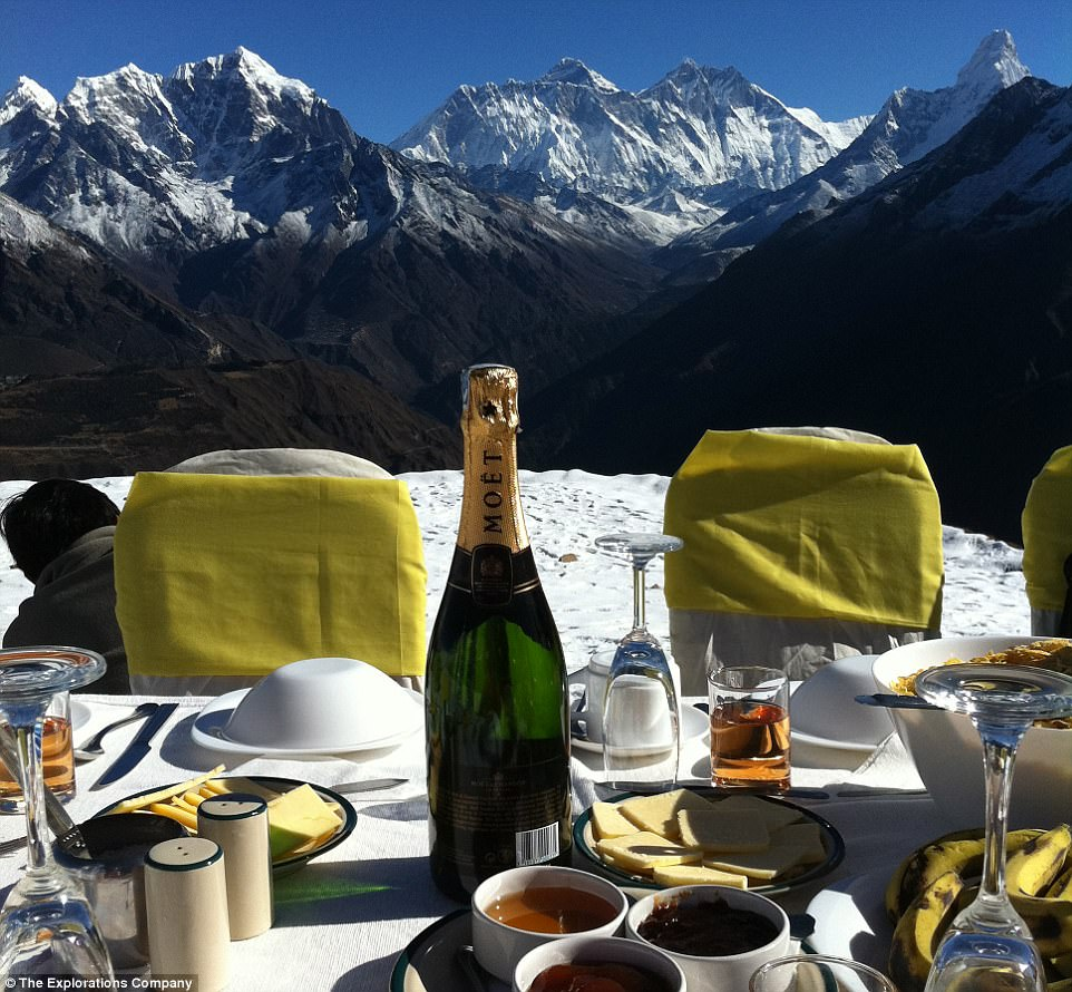 Popping the cork: A bottle of Champagne sits on the breakfast table with stunning mountain views behind