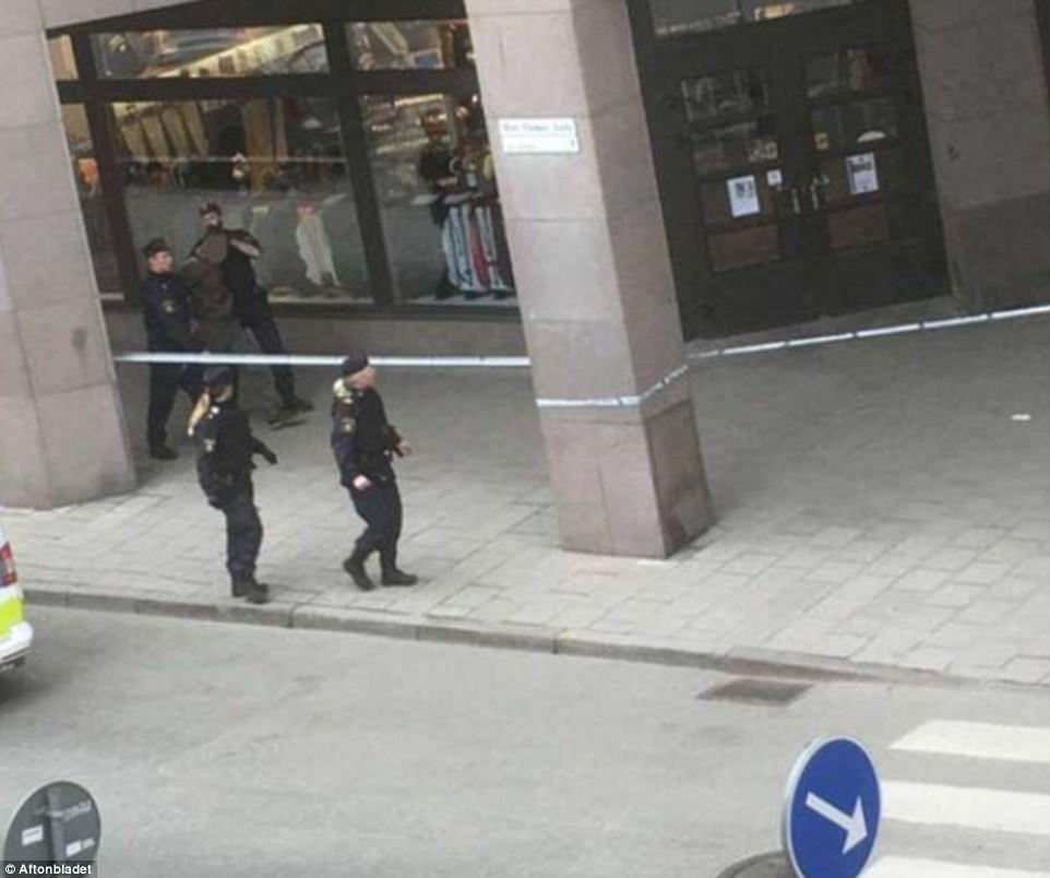 Above shows a man being apprehended by police. Witnesses say this is the driver but this has not been confirmed by Swedish police