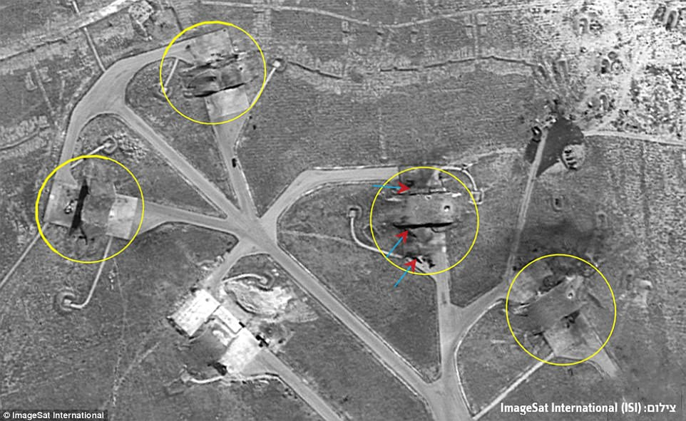 Aircraft shelters: This image shows how the missiles struck aircraft shelters on Thursday night after Syrian troops were warned