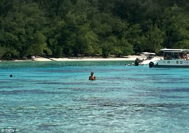 Vactioners said the former president (pictured in the ocean) looked very relaxed as he wrapped up his vacation