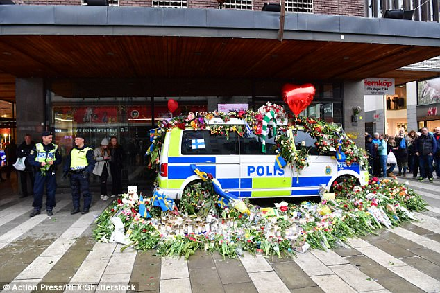 The scene of the terror attack in Stockholm has since been flooded with floral tributes