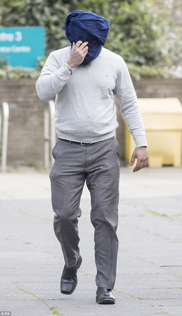 In the dock: Among the 29 in court today was Amere Singh Dhaliwal, 34, pictured, who is accused of 21 counts of rape and 30 other offences