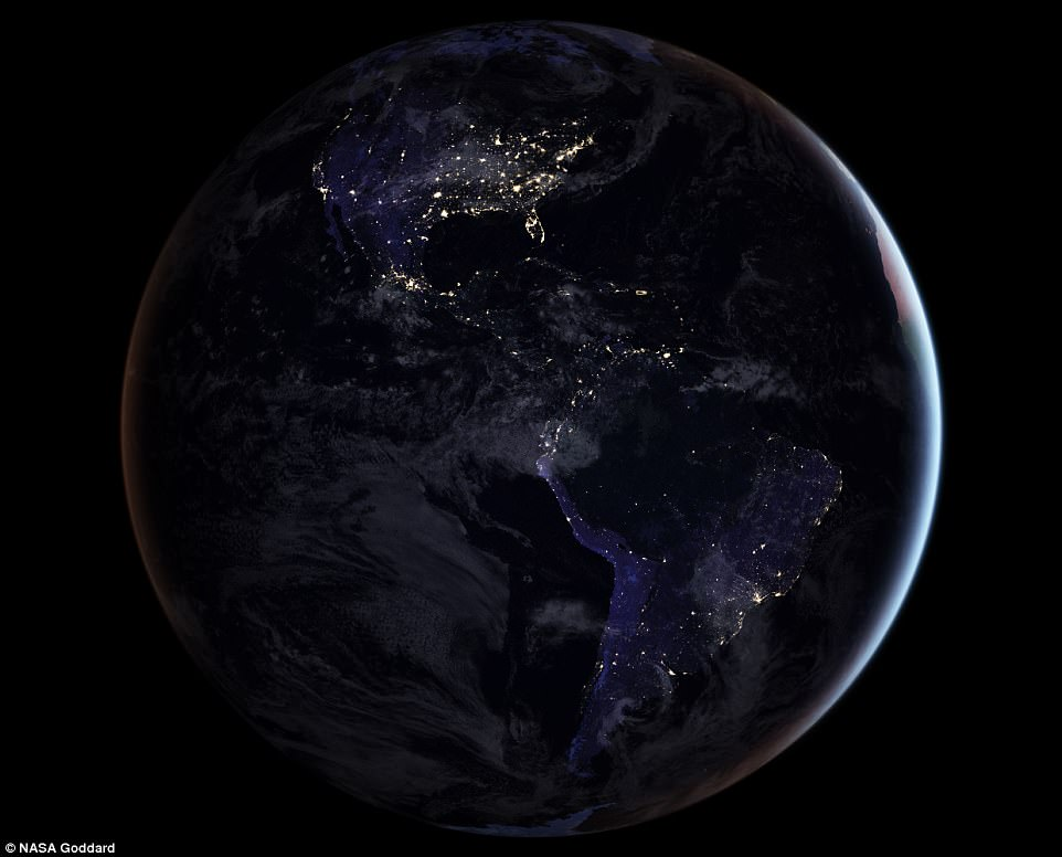 North (top) and South (bottom) America as seen from space. US's bustling cities shine brightly while a black void across the top of South America marks the location of the Amazon rainforest