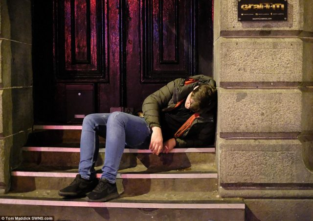 Another man was pictured slumped up against the wall of the Graffiti nightclub in Victoria Street, Liverpool
