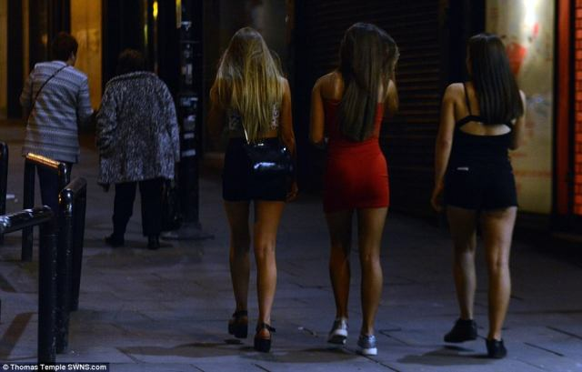 Party goers in Liverpool, pictured, were dressed to the nines as they made their way to bars and clubs in the city centre