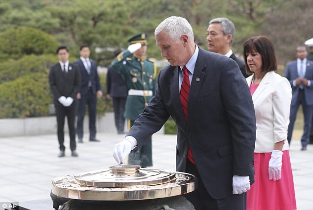 U.S. Vice President Mike Pence burns incense in front of his wife Karen Pence, right, at the Seoul National Cemetery in Seoul, South Korea