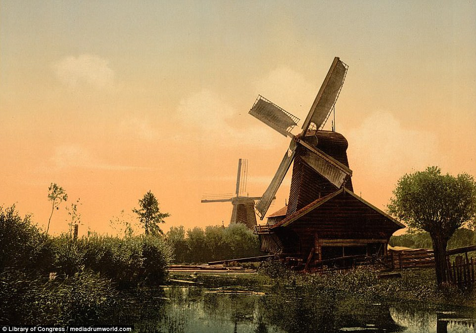The dazzling images show the country¿s traditional windmills at work, a spectacular arcade in Rotterdam and the National Monument of 1813 in Hague. This picture shows windmills in Dordrecht