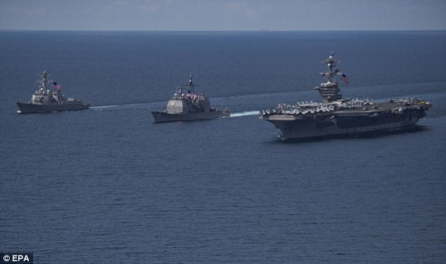 Donald Trump has already dispatched the giant USS Carl Vinson, powered by nuclear reactors, carrying almost 100 aircraft and accompanied by destroyers, a cruiser, and a submarine to the region. It is pictured (right) on Friday in the Indian Ocean alongsideUSS Michael Murphy (left) andUSS Lake Champlain (centre)